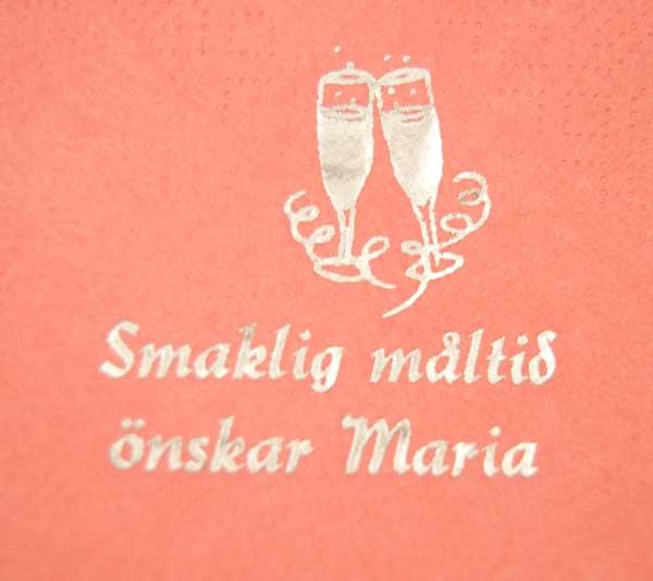 Servett med tryckta champagneglas